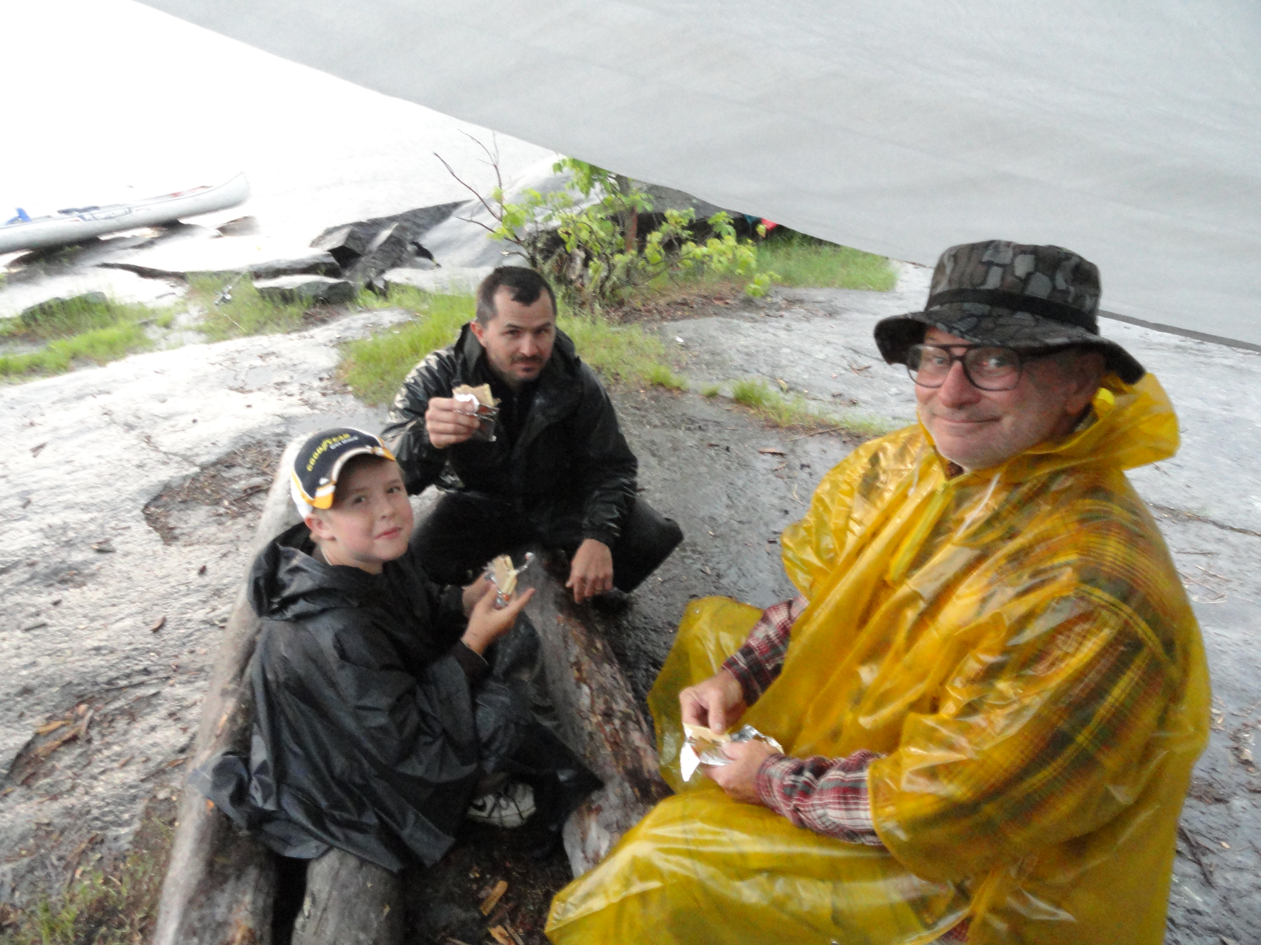 Eating pop-tarts under the tarp in the cold rain.